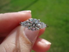 Round Brilliant With Pear-shaped Side Stones