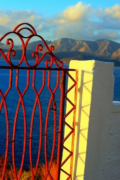 Red gate overlooking the sea, Kalymnos Island, Dodecanese, Greece