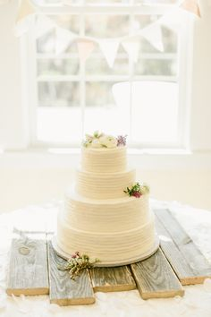 Rustic Wedding Cake With Roses On Pallet Crate