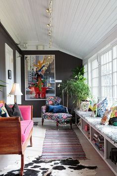 Fun colorful living room with a cozy  window seat. Yes!