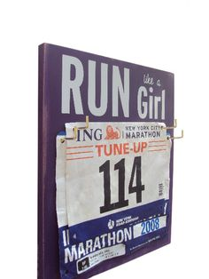 Race Bibs Hanger run like a girl by runningonthewall on Etsy, $26.00  Great for Bethany's room!