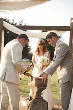 Wine box ceremony - the bride and groom write each other a love note, seal it and put it in a box with a yummy bottle of wine, then hammer the box shut. Only to open it should they have a disagreement, or on their 5th anniversary!  Photography by aeweddingsinc.com