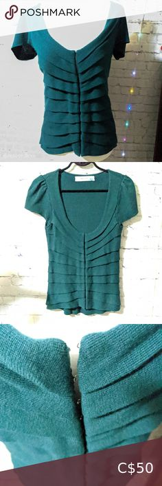 """🆕 Anthropologie""""Endless Pleats"""" Emerald Cardigan Gorgeous, soft emerald cardigan by Sparrow, sold through Anthropologie, """"Endless Pleats"""" style. V-neck. Pleated front with 15 hook and eye closures running up and down the front.   Flutter sleeves.   In excellent, near like-new condition. No notable flaws or pilling. Never really worn much.  Size medium. Runs slightly small.  Fabric: 100% cotton  Approx. Measurements Chest: 16"""" Length: 26"""" Anthropologie Tops Plus Fashion, Fashion Tips, Fashion Trends, Flutter Sleeve, Emerald, Anthropologie, Flaws, V Neck, Running"""