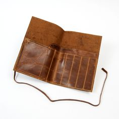 The easiest, most convenient way to carry your pens, pencils and business cards around is in this stylish roll-up wrap. Made from rustic leather and a secure wrap closure, it has individual compartmen