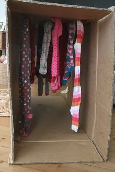 Create a play tunnel from a cardboard box and scarves!