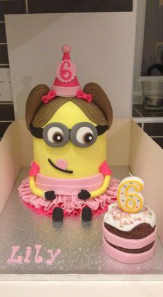Minion cake! Made to look like the birthday girl! Follow us on Facebook www.facebook.com/captivatingcake