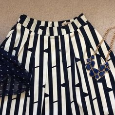 """Exotic print skirt w/ pleats--and pockets!! Pure heavy cotton. Navy and cream. Back zip and two side pockets. Fully lined. Worn 2x. Excellent like-new condition. Flat, the waist measure 13"""". The length from top of waistband measures 27"""". Miss Patina London Skirts Midi"""