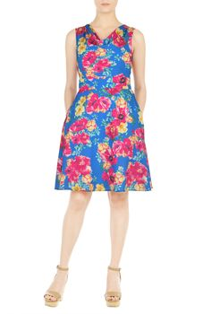 A draped neckline and banding at the inset high waist style our floral print crepe dress with a full skirt for a flirty twirl.