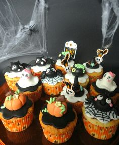 Cute Halloween Cupcakes, The little girl ghost is adorable! I tried to find a source for this, but unsuccessful.