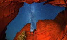 Salt Lake City photographer Royce Bair uses digital cameras and what he describes as a 'copious collection of flash lighting equipment' to capture his unique views of the night sky over Utah's spectacular canyons.