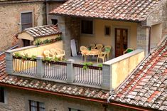 Tuscan garden ideas - love the roof tiles and patio/balcony