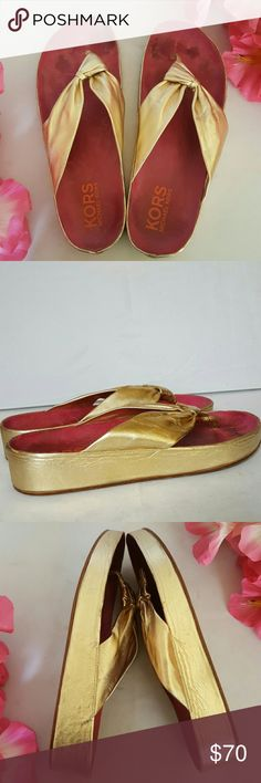 """Kors Michael Kors Gold Leather Thong Sandals Shiny gold leather upper features 1.5"""" leather wrapoed heel. Good pre loved condition showing some wear on outsoles . KORS Michael Kors Shoes Sandals"""