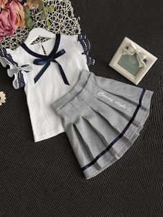Shop Girls Contrast Lace Ribbon Detail Top With Skirt online. SHEIN offers Girls Contrast Lace Ribbon Detail Top With Skirt & more to fit your fashionable needs. Baby Girl Fashion, Kids Fashion, Latest Fashion, Baby Dress Design, Baby Skirt, Baby Frocks Designs, Baby Dress Patterns, Kids Frocks, Little Girl Dresses