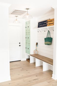 Custom built drop zone with mint colored lockers. The drop zone is a place for shoes, purses, backpacks, etc. to gather before those items invade and take over your home - as featured on 'Rafterhouse' pilot show on HGTV.