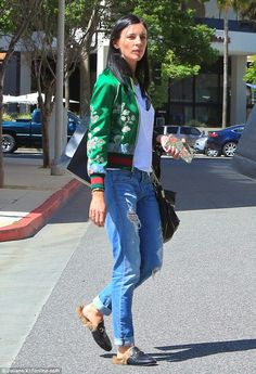 Sunkissed: Liberty Ross, 37, cut a cool figure as she stepped out for a shopping spree with her man, 63, at Barneys NY in Beverly Hills on Wednesday