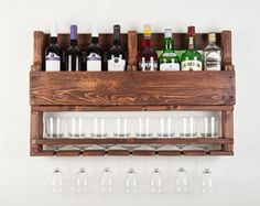 If you are a whiskey lover this wine rack wall mounted made from reclaimed wood is the perfect match for you! It can be a great option as a a housewarming gift, gift for men, gift for groom, wedding gift, gift for boyfriend.  This rack would look amazing in a cigar bar or next to your alcohol collection at home or office. It is made from reclaimed pallets and its a fabulous way to display your love for whiskey.  It has hangers on the back and we will send you all the assembly materials for…