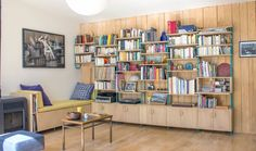 Living room D. Integration of several demands : a bookshelf, a bench, some closed storage boxes, a secretary and a wood log trunk for the stove. The result is a cosy living room enhanced by a great piece of tailored furniture.  Fabrics from kvadrat.