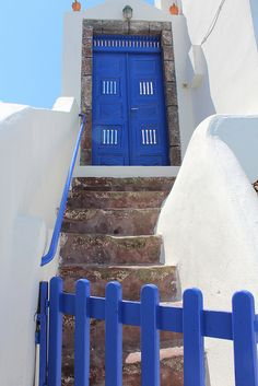 GREECE CHANNEL | Oia, Santorini, Greece. White & Blue Got a photo of these doors, they fascinated me.