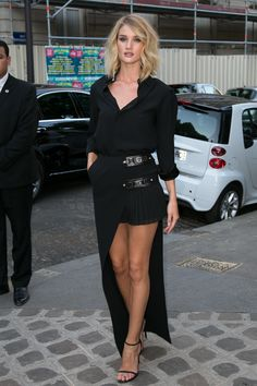 In Versus Versace while arriving at an event in Paris.   - ELLE.com
