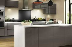 Entertain in style with the stunningly chic Holborn Gloss Grey kitchen. The deep grey, lacquered units, complete with integrated handles, offer the ultimate in sophisticated style and high end fashion for your home. Benchmarx Kitchen, Grey Kitchen Cabinets, Kitchen Units, Kitchen Living, Kitchen Interior, Kitchen Decor, Kitchen Ideas, Ikea Hacks, Grey Gloss Kitchen