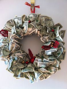 Money wreath...how cool and unique! We just made one for a retirement gift for a coworker. She loved it!