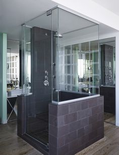 Freestanding glass enclosed shower in Naeem Khan's, Miami penthouse.