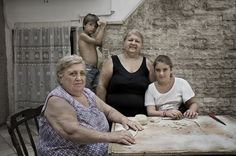 Alessia, her grandmother, and great-grandmother gather around their worktable on Bari Vecchia in Puglia, Italy.