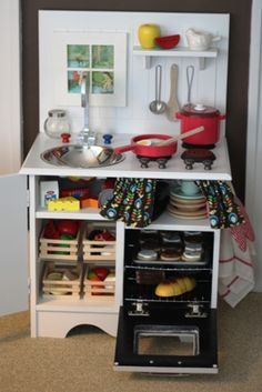 From Nightstand To Play Kitchen by objective:home:  Any little kiddo would love a play kitchen like this one and it's a converted nightstand! I especially like the black oven with a red heat element inside! So cute!