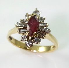 18K GOLD DIAMOND AND MARQUISE RUBY RING