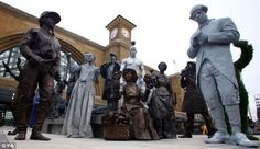 Performers dressed as familiar London characters - fifteen living statues were part of the opening of the newly redeveloped King's Cross Square.