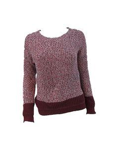 Jersey de punto con aire retro. Bicolor, con la parte posterior de color liso y el resto jaspeado en el mismo tono. Disponible en dos colores.