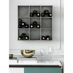 An alternative to Stact for wall-mounted wine storage.  I probably like Stact better -- more minimalist, though these might coordinate better with certain ceiling lights (and they're cheaper).