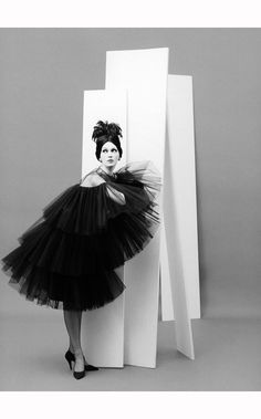Dovima in tiered, tulle party dress from Dior's (YSL) Autumn:Winter Collection 1958, Courbe Line,Paris studio, August 1958 © Richard Avedon