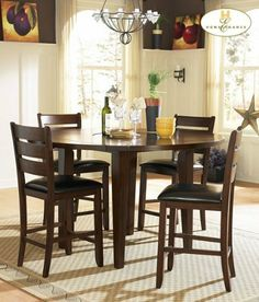 Home Elegance 586-36RD Ameillia Round Counter Height Drop Leaf Table by Homelegance. $589.07. Dimension: 60 Dia (42 x 42) x 36 H.. Drop-leaf table.. Leaf Drop: 9.. Finished in dark oak with birch veneer.. Contemporary design inspired by the Arts & Crafts movement.. AMEILLIA COLLECTION Blending the clean lines of Arts Crafts with functional movement, the Ameillia Collection is a solid addition to your casual dining space. The drop-leaf counter height table features ...
