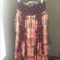 Free People Midi Skirt Free people- Flowy Midi Skirt. Brand new condition/worn only a few times. Black and pink with paisley print. Elastic waist for a comfy stretch fit. Beautiful spring / summer skirt!! Size Small. Free People Skirts Midi