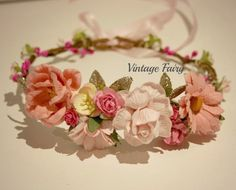 Welcome to Vintage Fairy This flower crown is oh so pretty, lovely to wear for any occasion Stunning flowers sit to the front of the crown with pretty champagne sparkle leaves in amongst the flowers.Gorgeous small blossoms circle the crown along with lovely pink and white berries .Our crowns are made with a strong wire base, giving it extra strength especially when little ones are wearing them. You will find many flower crowns around that do not use a strong base. Go f...