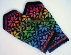 Hand knitted wool mittens. Warm mittens. Winter unisex mittens. Rainbow. The rainbow color star ornaments on a black background. Gift idea.