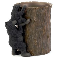 The Black Bear Lodge Wastebasket features a mother bear and her cubs delightfully rendered in this stylish resin design. Add rustic charm to any décor using this fun bathroom accessory.