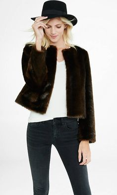 The luxe feel and look of mink fur in a stylish, waist-legnth jacket. It's a glamorous accomplice to your favorite black dress and over-the-knee boots.