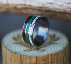 Titanium Wedding Band with Ironwood, Malachite & Antler Inlays. Handcrafted by Staghead Designs.