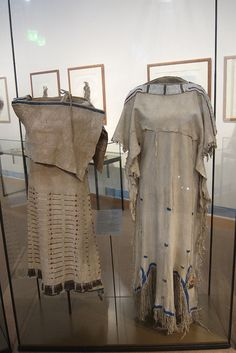 Left: Side-Fold Dress - Lakota (1830) Right: Woman's Dress (1840)
