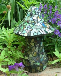 """15"""" mushroom covered with Oceana stained glass and glass beads. This was supposed to be an easy project. Harder than you think nipping out pieces to fit. Will look good hiding within the plants."""