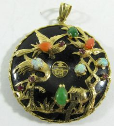 """Lot 33a in the 4.26.14 online & live auction! Gorgeous round 14kt yellow gold pendant with Oriental style design. Intricate 14kt gold bird scenery design over large black stone, possibly onyx. Pendant is accented with colorful gemstones including, opal, jade and possibly amethyst and coral. Marked """"14k 585"""", measures: 2"""" long. Total weight: 8.3 dwt. #Jewelry #Fashion #Shopping #POGAuctions"""