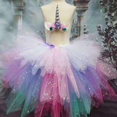 This tutu is a mix of sparkly turquoise, purple, pink and white with a matching headband horn. The waist band in the tutu skirt is elasticated and has a lot if stretch to it. This is a medium length tutu. Perfect for parties and special occasions.