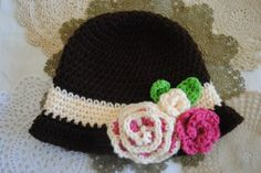 Red Heart Free Spring Crochet Cloche Hat Pattern with flowers.