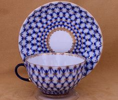 Lomonosov Russian Porcelain Cobalt Net Teacup and Saucer     I lost this in the Northridge earthquake but we didn't get hurt. :)
