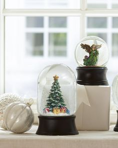 Holiday snow globes and ornaments to leave a wintry charm on your window sill.
