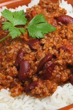 Recipe including course(s): Entrée; and ingredients: beef stock, canned chili beans, chili powder, garlic, ground turkey, onion, salt, tomato paste