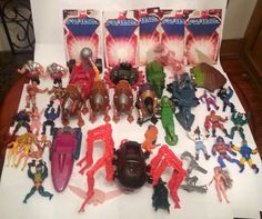 HUGE LOT OF HE-MAN MASTERS OF THE UNIVERSE ACTION FIGURES WITH WEAPONS AND MORE!