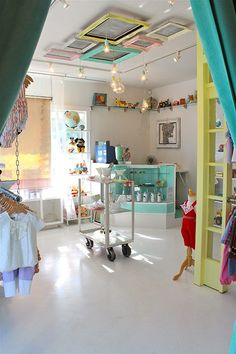 Shella Garcia recently opened a children's boutique for new and vintage clothing, toys and accessories in Long Beach, California. With a color palette akin to a bag of Jordan Almonds, there are some ideas here you could steal for your own child's room.